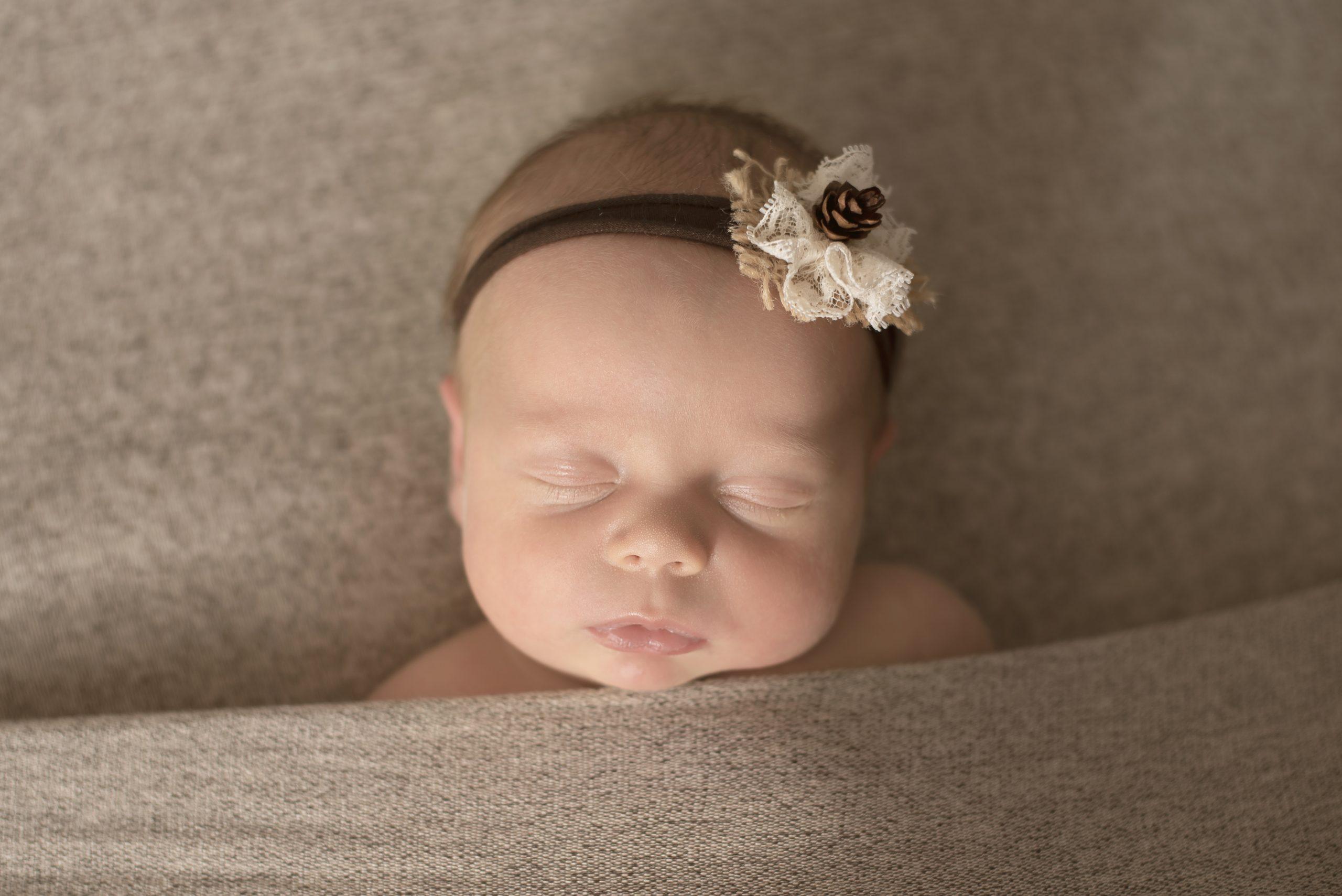 Hannah tucked in pose CNY Newborn Photography