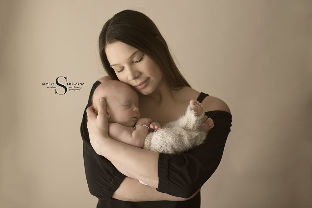 Nevaeh in mom's arms  CNY Newborn Photography