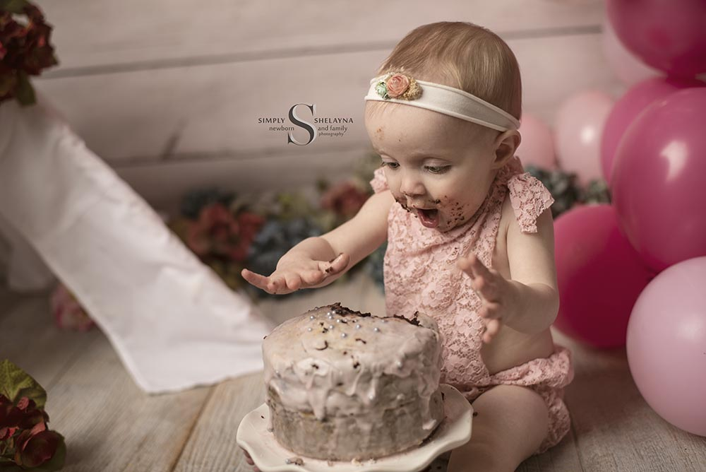 Adilyn patty caking her cake!